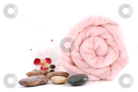 Spa stock photo, Pink rolled up towel with massage stones on white background by Elena Elisseeva