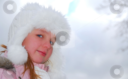 Girl winter hat stock photo, Portrait of young girl wearing white winter hat outside by Elena Elisseeva