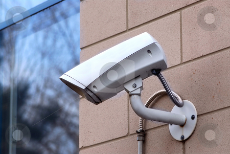 Security camera stock photo, Security video camera on outside wall of a building by Elena Elisseeva