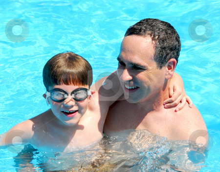 Father son pool stock photo, Father and son having fun in a swimming pool by Elena Elisseeva