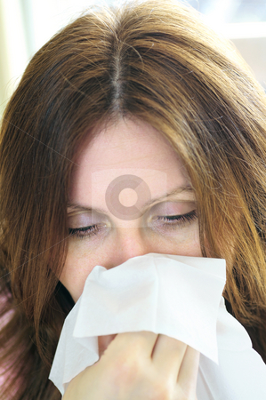 Woman with flu or allergy  stock photo, Mature woman with a flu or an allergy symptoms by Elena Elisseeva