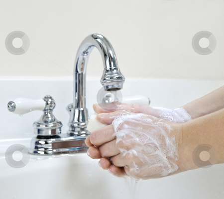 Washing hands stock photo, Child washing hands with soap under running water by Elena Elisseeva