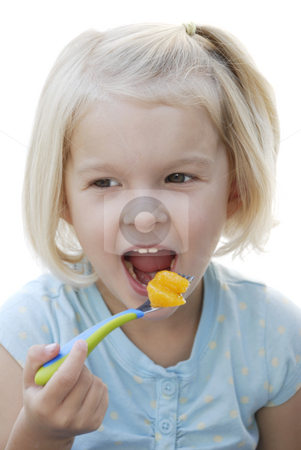Girl with Fork stock photo, Young child eating tangerine on a fork.  Isolated on a white background by A Cotton Photo