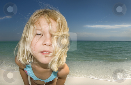 Child on Beach Close-Up stock photo, Child looking into the camera on a beautiful sunny day at the beach by A Cotton Photo