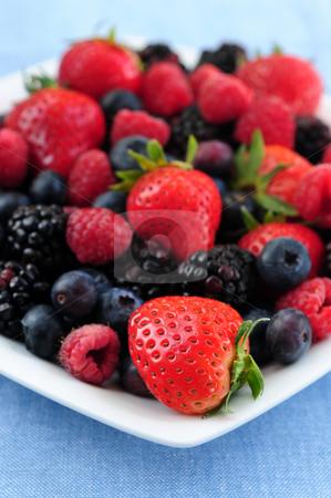 Assorted fresh berries stock photo, Assorted fresh berries on a plate close up by Elena Elisseeva