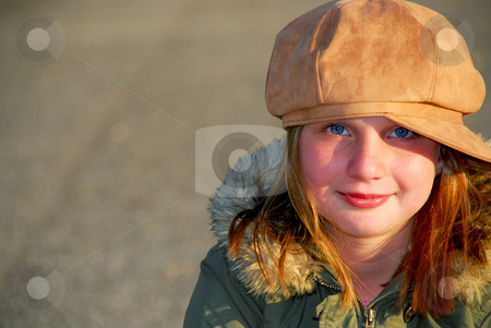 Girl winter hat stock photo, Portriat of a happy smiling girl in winter or fall clothes outside by Elena Elisseeva
