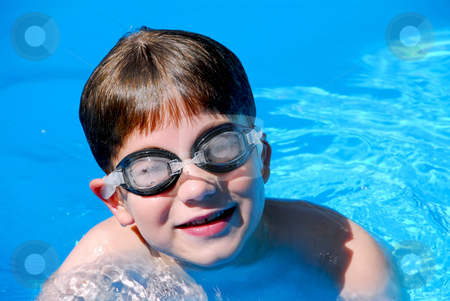 Boy child pool stock photo, Cute little boy having fun in a swimming pool by Elena Elisseeva