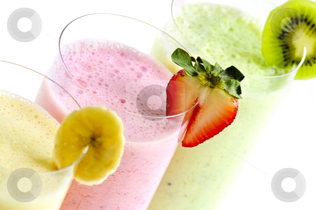 Assorted fruit smoothies stock photo, Assorted fruit smoothies close up on white background by Elena Elisseeva