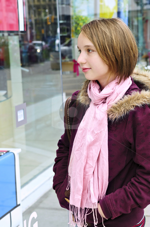 Teenage girl shopping stock photo, Teenage girl window shopping on city street by Elena Elisseeva