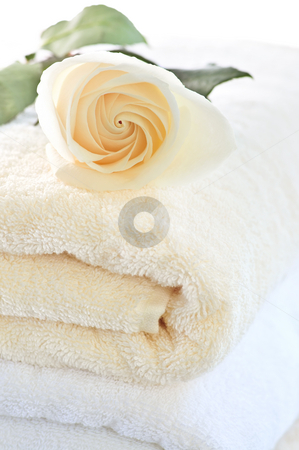 Stack of towels and rose stock photo, Stack of soft luxury towels with fresh flower by Elena Elisseeva