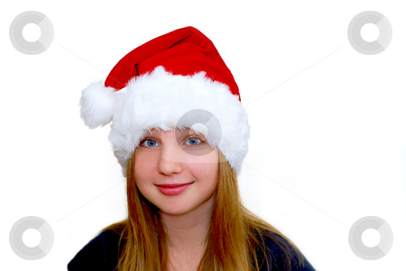 Girl with santa hat stock photo, Portrait of a young girl wearing Santa's hat isolated on white background by Elena Elisseeva
