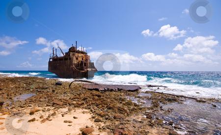 Shipwreck stock photo, Rusty caribbean shipwreck washing ashore by Karin Claus