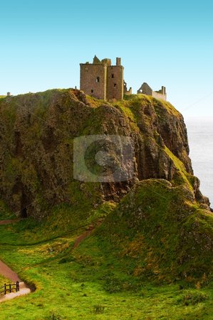 Dunnottar castle stone haven stock photo, Dunnottar castle on a cliff vovered with grass by Karin Claus