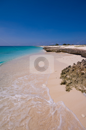 Tropical beach stock photo, Tropical beach with turquoise sea and rocky shore by Karin Claus