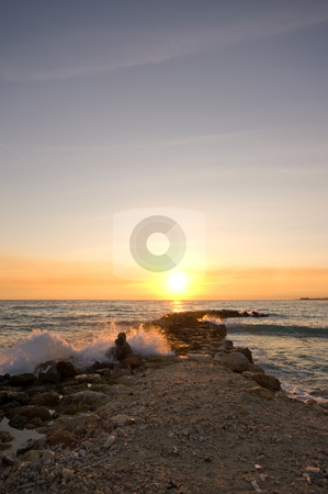 Wave breaker sunset stock photo, Pastel sunset with wave breaker in front by Karin Claus