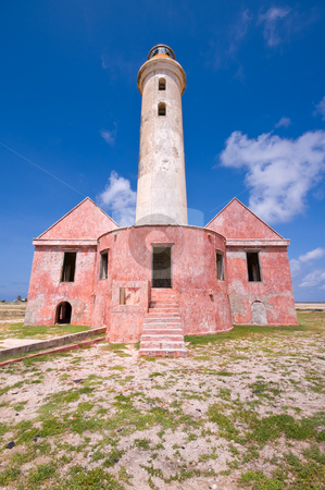 Ancient lighthouse ruin stock photo, Ancient lighthouse ruin on little curacao against blue cloudy sky by Karin Claus