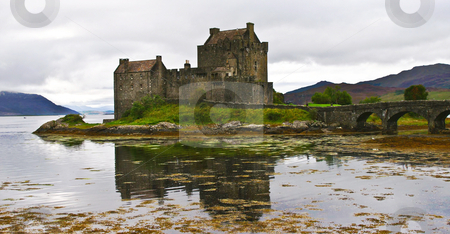 Ancient castle stock photo, Eilean donan castle on a cloudy day by Karin Claus