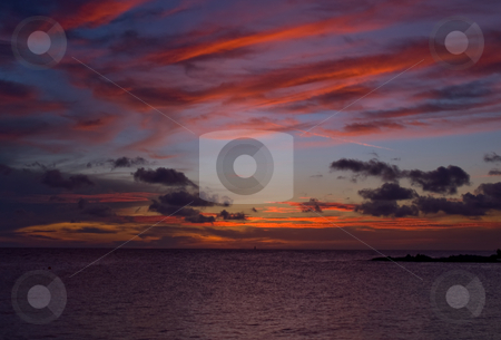 Sea sunset stock photo, Sunset over the sea with nice vivid colors by Karin Claus