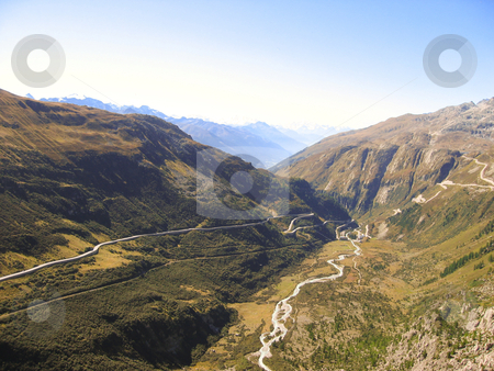Mountain scape stock photo, Mountain scape with road and river visible in the valley by Karin Claus