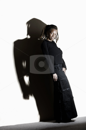 Pretty African American Woman stock photo, African American woman with dreadlocks against a white wall by Scott Griessel