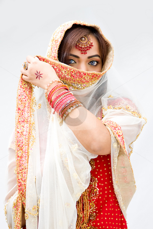 Woman with veil stock photo, Elegant Bengali bride with veil in front of mouth, isolated by Paul Hakimata
