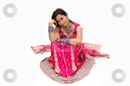 Beautiful Bengali bride stock photo, Beautiful Bengali bride in colorful dress day dreaming, isolated by Paul Hakimata