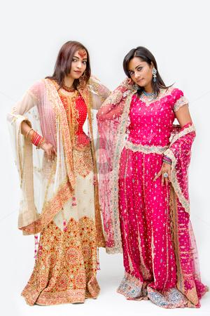 Bangali brides stock photo, Two beautiful Bangali brides in colorful dresses, isolated by Paul Hakimata