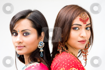 Beautiful Bengali brides stock photo, Two beautiful Bengali brides in colorful dresses, isolated by Paul Hakimata