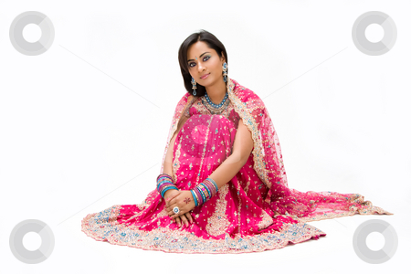 Beautiful Bangali bride sitting stock photo, Beautiful Bangali bride in colorful dress sitting, isolated by Paul Hakimata