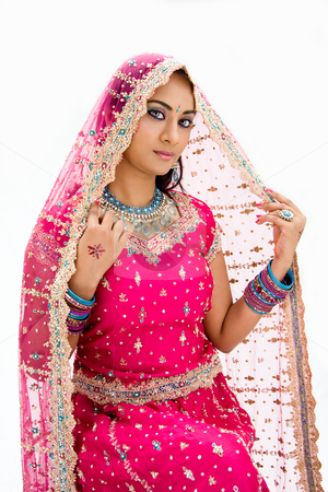 Beautiful Bangali bride stock photo, Beautiful Bangali bride in colorful dress and veil, isolated by Paul Hakimata