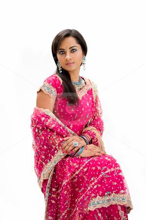 Beautiful Bangali bride stock photo, Beautiful Bangali bride in colorful dress sitting, isolated by Paul Hakimata