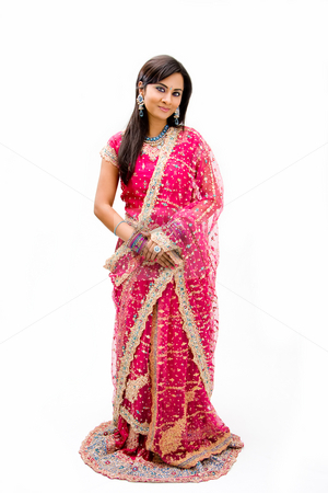 Beautiful Bangali bride stock photo, Beautiful Bangali bride in colorful dress standing, isolated by Paul Hakimata