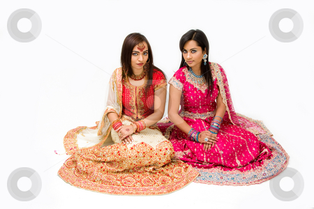 Harem girls stock photo, Two beautiful harem girls or belly dancers or Hindu brides sitting, isolated by Paul Hakimata
