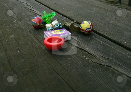 Toys on Bench stock photo, Toys sitting on a bench. by Julie Bentz