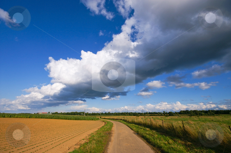 Thunder cloud stock photo, Very big thunder cloud over a rural farmlandscape by Karin Claus