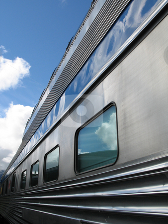 Silver passenger train stock photo, Silver passenger train by Mbudley Mbudley