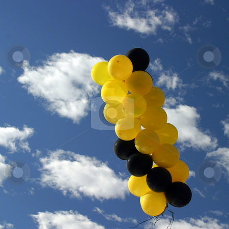 Yellow Black Ballons stock photo, Yellow and black ballons with a blue cloudy sky by Henrik Lehnerer
