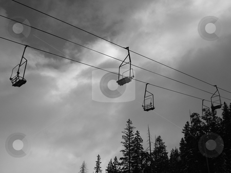 Black and White Ski Lift stock photo, An empty ski lift in the Colorado Rockies during Winter. by Ben O'Neal