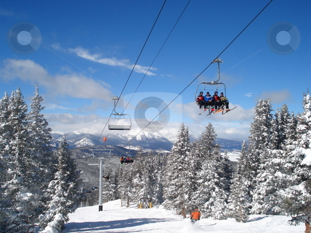 Winter Ski Lift stock photo, A ski lift carries anxious skiiers to the top of a Colorado ski resort in Winter. by Ben O'Neal