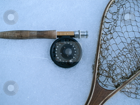 Fly Fishing Gear stock photo, Some fly fishing gear laying on the snow near a Colorado river. by Ben O'Neal