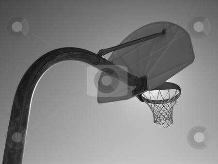 Basketball Goal in Black and White stock photo, A basketball goal stands against a clear sky in black and white. by Ben O'Neal