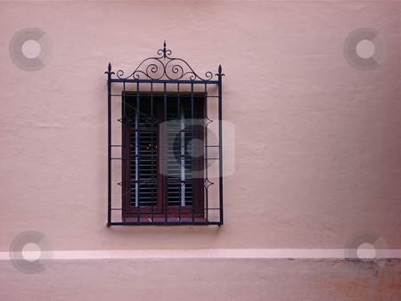 Single Window stock photo, An ornate window on a salmon colored wall. by Ben O'Neal