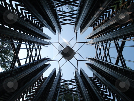 Abstract Metal Construction stock photo, A large metal art installation shines in the afternoon sunlight. by Ben O'Neal