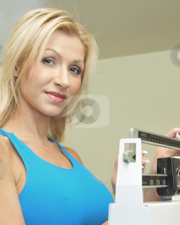 Woman Working Out  stock photo, Woman doing her daily work out at the gym by Timothy OLeary