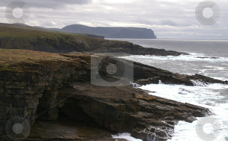 Coastal cliffs stock photo, Coastal cliffs on a dark cloudy day by Karin Claus