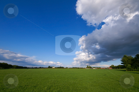 Green pasture and thunder  stock photo, Green pasture with big thundercloud overcast by Karin Claus