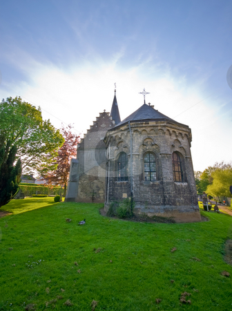 Holy church   stock photo, Little medieval church with aura of light above the roof by Karin Claus