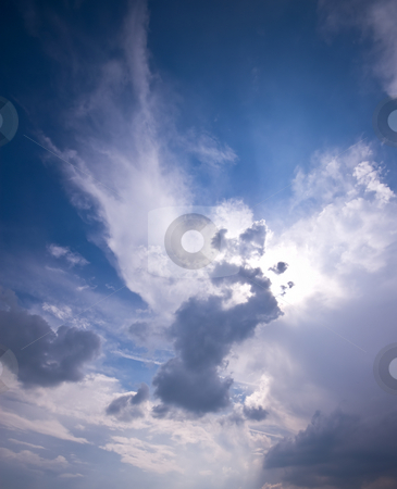 Clouds stock photo, Shining clouds with sun hidden underneith by Karin Claus