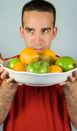 Fresh Fruit stock photo, A man smelling some fresh fruit in a bowl by Richard Nelson