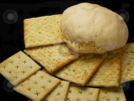 Bread and crackers stock photo, Fresh bread and crackers on black background by Francesco Perre